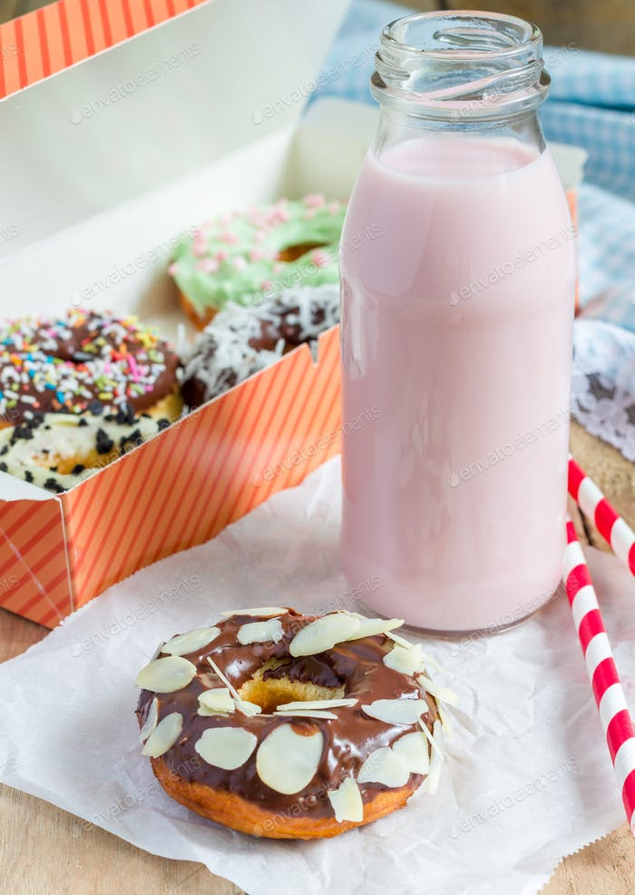 Homemade colorful donuts with strawberry milk drink