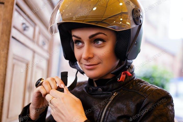 A woman wearing a moto helmet.