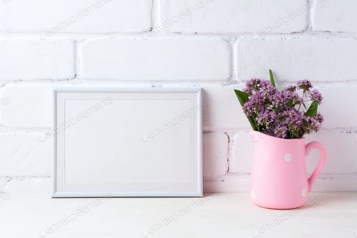 White landscape frame mockup with purple flowers in polka dot pi