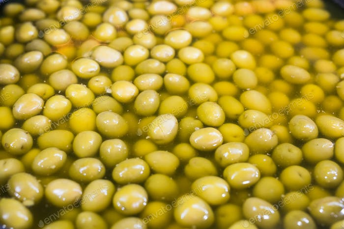 A lot of fresh green olives in a bowl