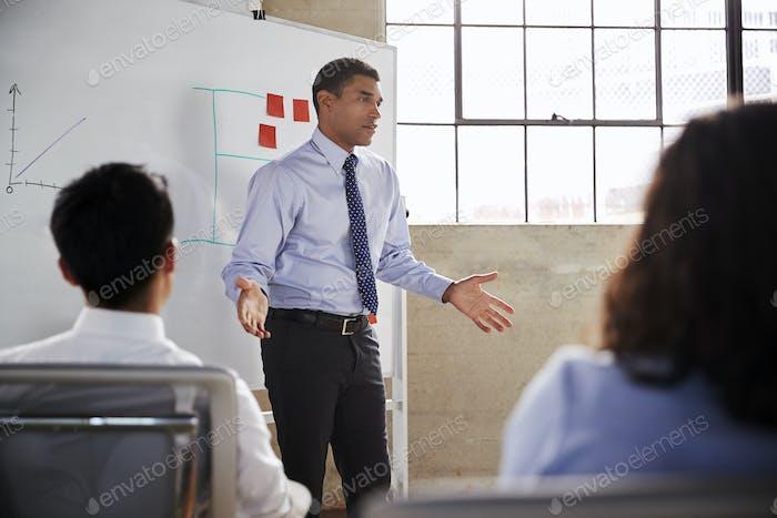 Businessman gesturing during a presentation, close up