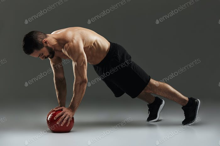 Portrait of a concentrated muscular sportsman