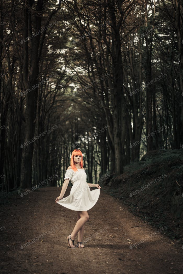 Young woman with white dress on forest