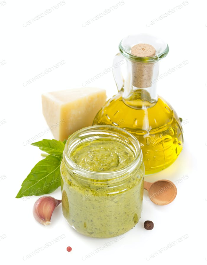 pesto sauce in jar on white background