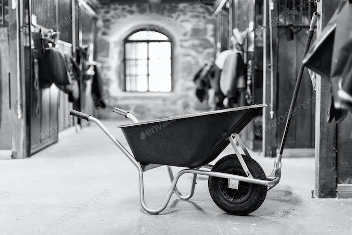 Wheelbarrow in stable