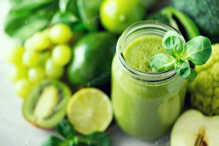 Glass jar mugs with green health smoothie. Copy space. Vegan, vegetarian concept. Alkaline food