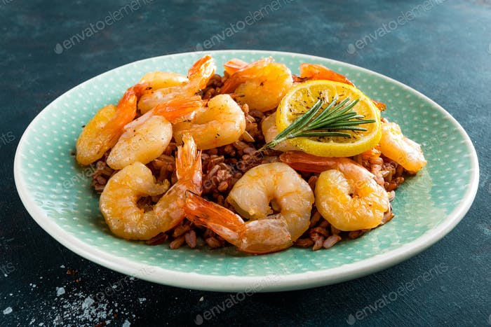 Prawns roasted on grill and rice
