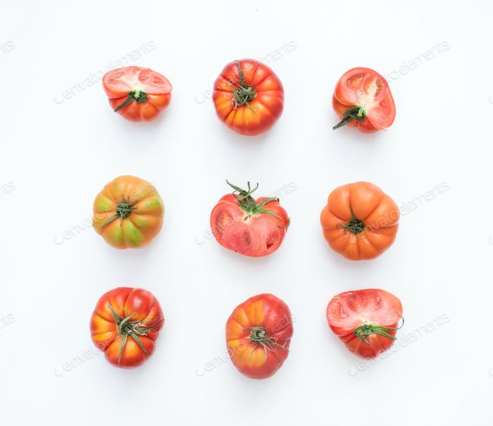 Selection of heirloom tomatoes on a white backdrop.