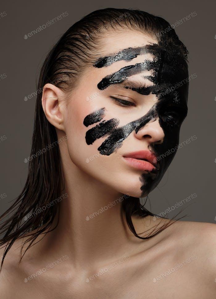 Portrait Of Fashion Model. Black Painting Face Make-up.