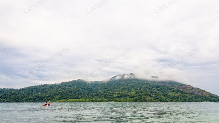Two tourists are kayaking in the sea at Ko Adang island