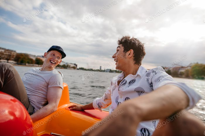 Teenage boys enjoying boating in the lake