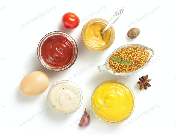 tomato sauce, mayonnaise and mustard on white background