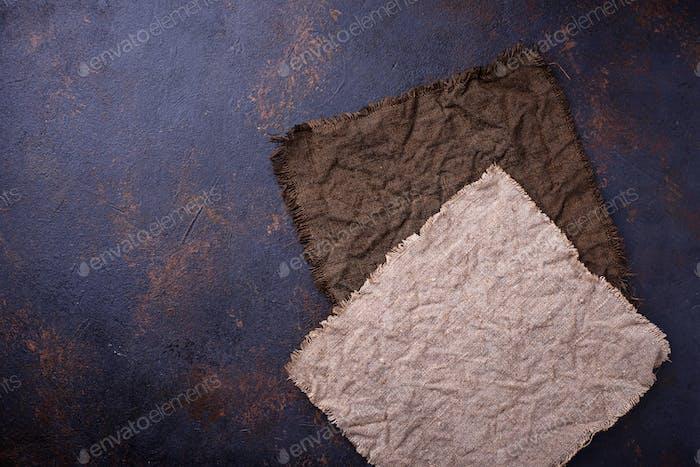 Linen tablecloth on concrete background.