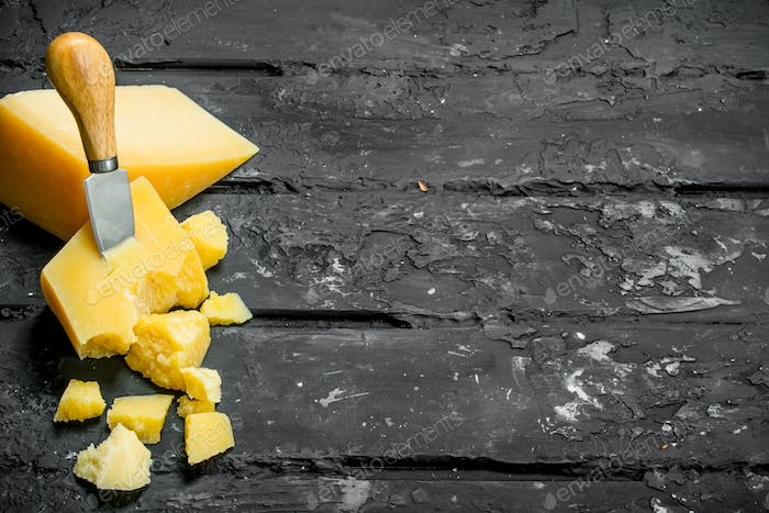 Parmesan cheese with knife.