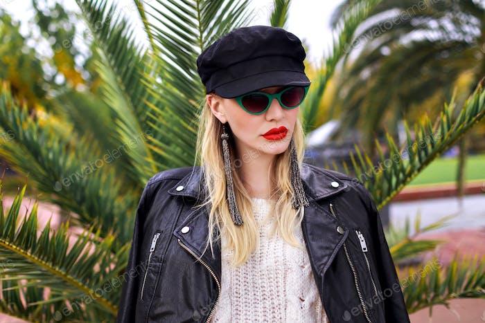 Outdoor fashion image of stylish elegant woman posing at Barcelona streets near palm trees