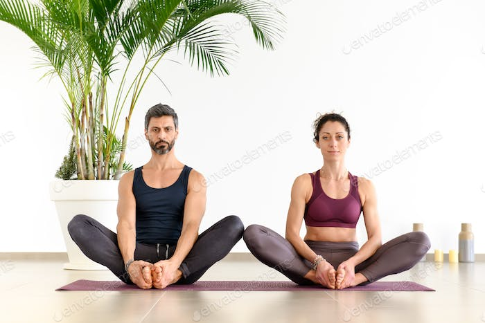 Man and woman during yoga meditation