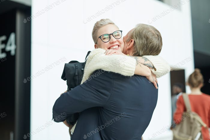 Young Woman Embracing Her Father