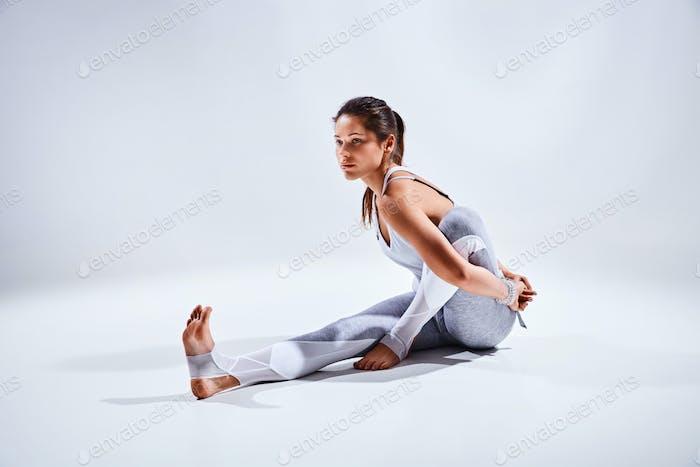 Woman doing yoga isolated on white background