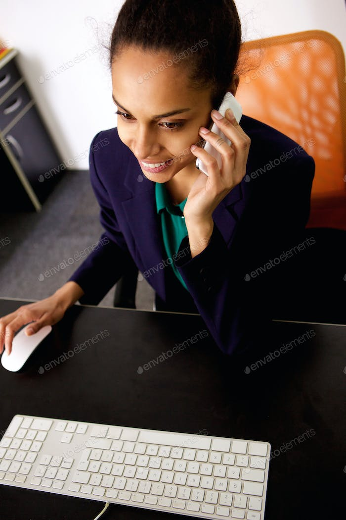 Young african business woman working at her desk