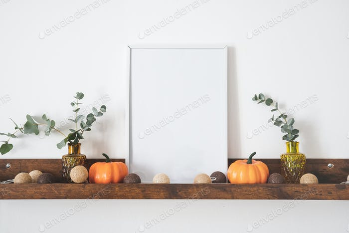 White picture frame with copy space on brown shelf