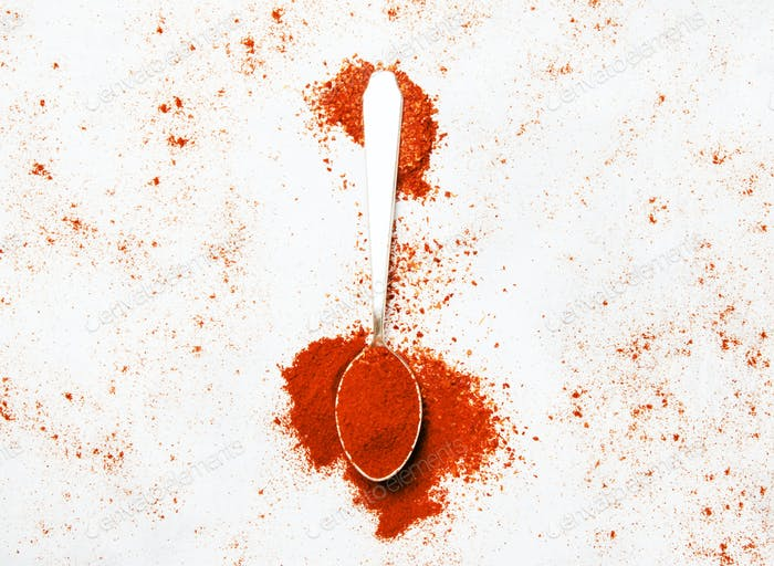 Ground chili pepper in a silver spoon
