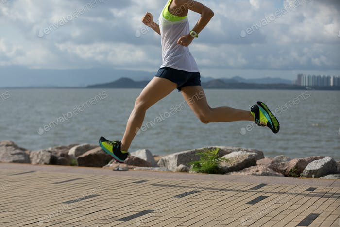 Runner training for marathon running at seaside