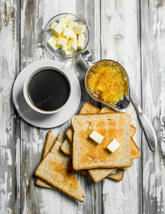 Breakfast. Toasted bread with butter and hot coffee .