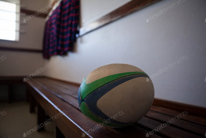 Close-up of rugby ball on bench