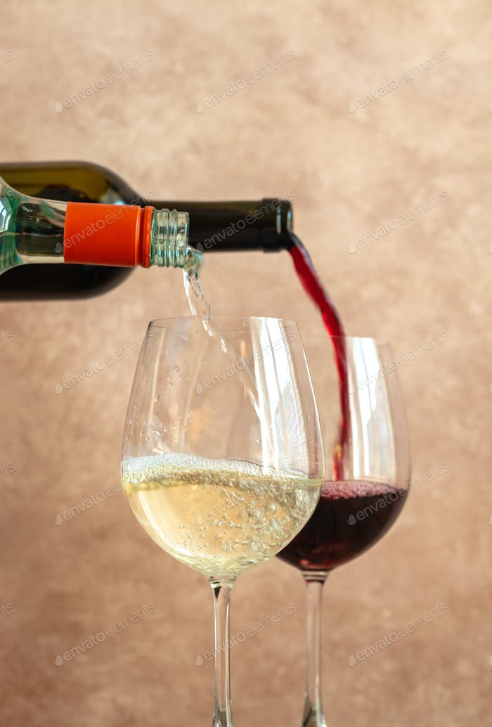 White and red wine pouring into glasses