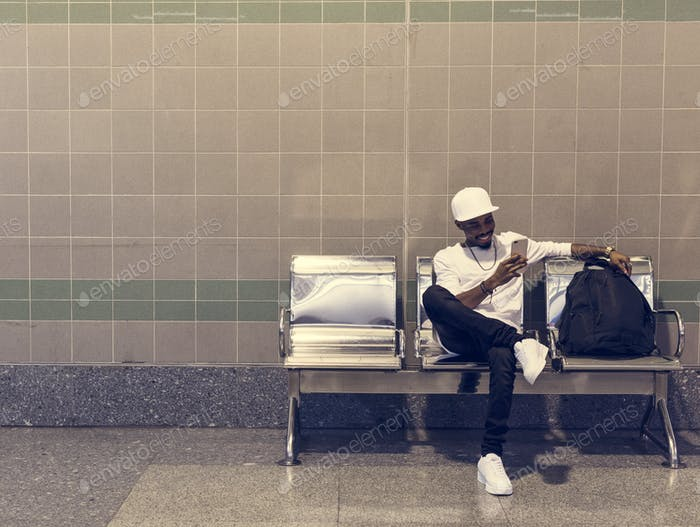 African man sitting on a waiting chair