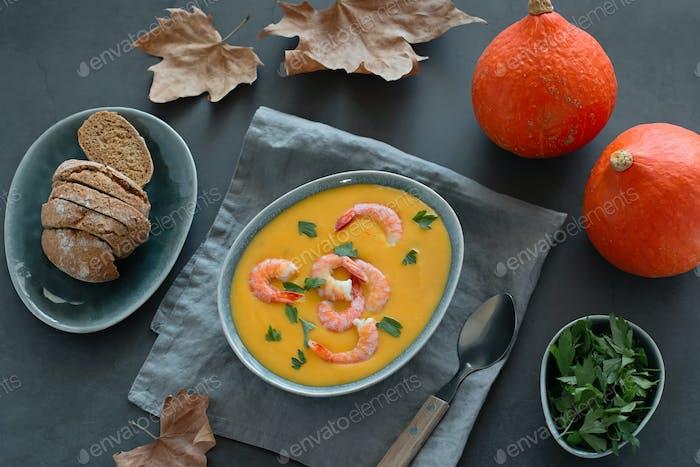 Bowl with pumpkin and shrimp cream soup