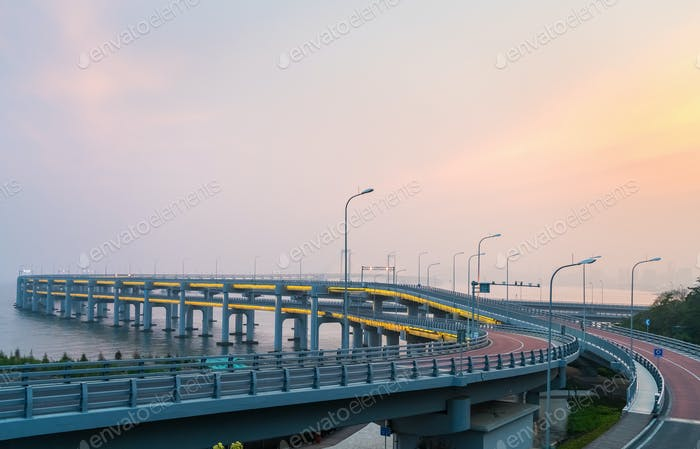 dalian bay bridge in sunset