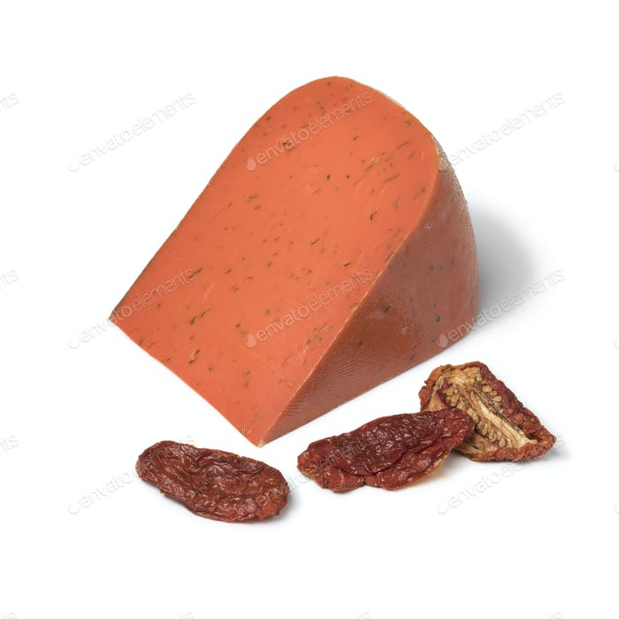 Piece of red pesto gouda cheese