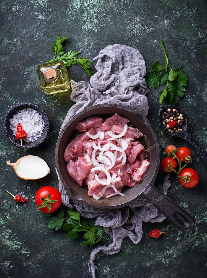Raw sliced meat ready for cooking.