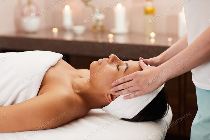 Young Woman Enjoying Face Massage