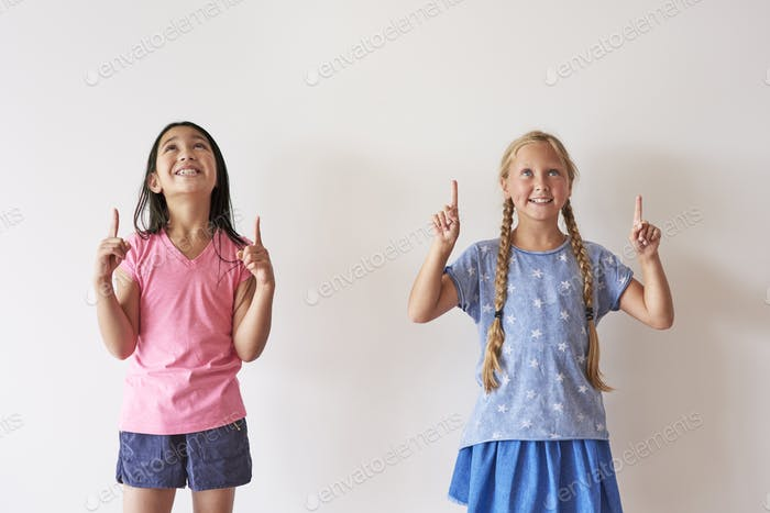 Two friends with fingers up