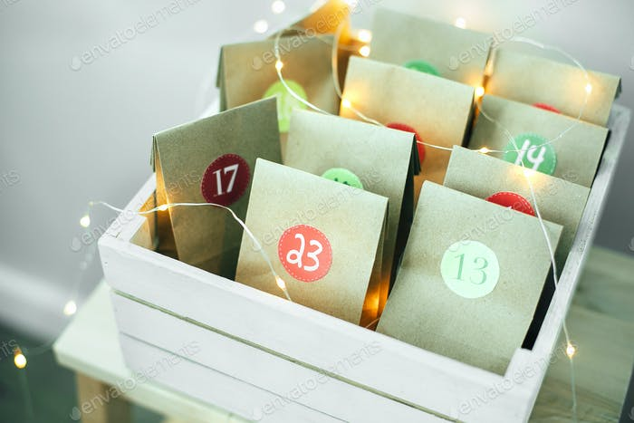 Christmas advent calendar. Eco paper bags with presents for kid's. Sustainable christmas.