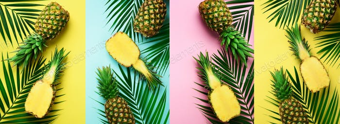 Pineapples, palm leaves on pastel colorful yellow, pink, turquoise background with copy space