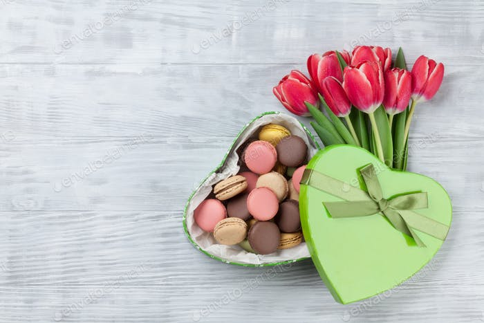 Red tulip flowers and macaroon cookies