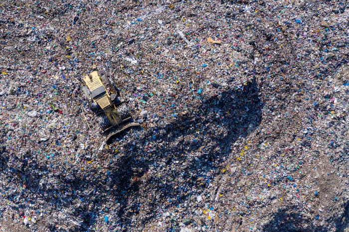 Aerial view of large landfill. Waste garbage dump, environmental pollution