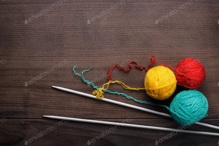 Knitting Needles And Ball Of Threads