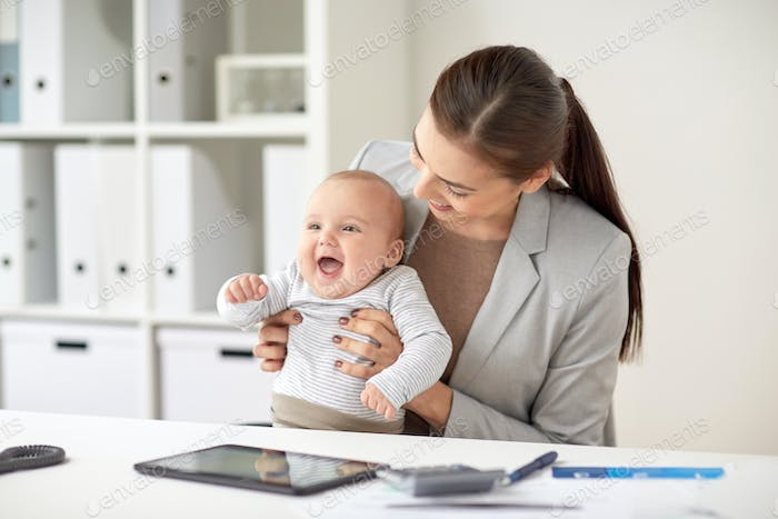 happy businesswoman with baby working at office