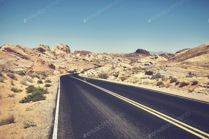 Retro stylized picture of a desert road.