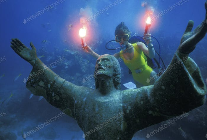 A scuba diver with underwater flares, celebrating the 25th anniversary of the placement of the