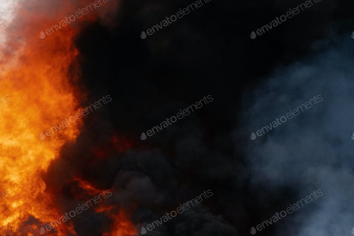Huge Flames of Red Fire, Motion Blur Clouds of Dark Smoke Covered Sky