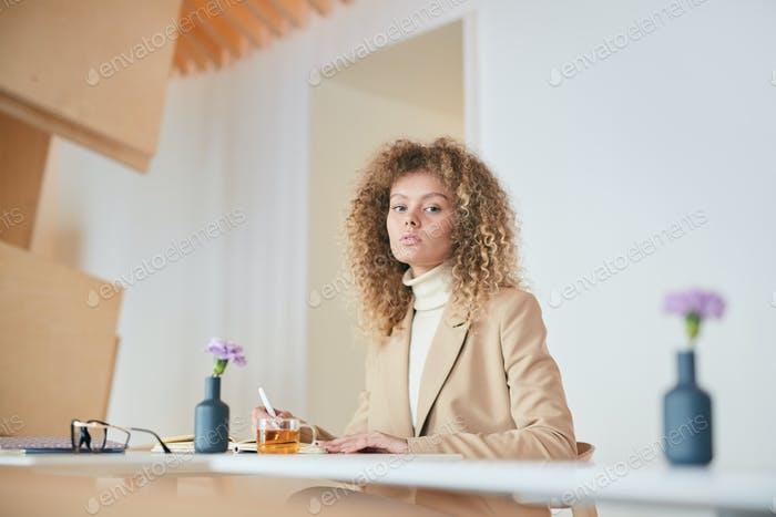 Young Businesswoman in Modern Cafe