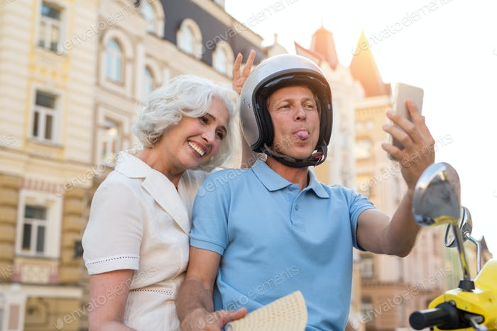 Mature couple looks at phone