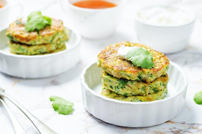 Zucchini ricotta cilantro fritters with fresh cilantro leaves