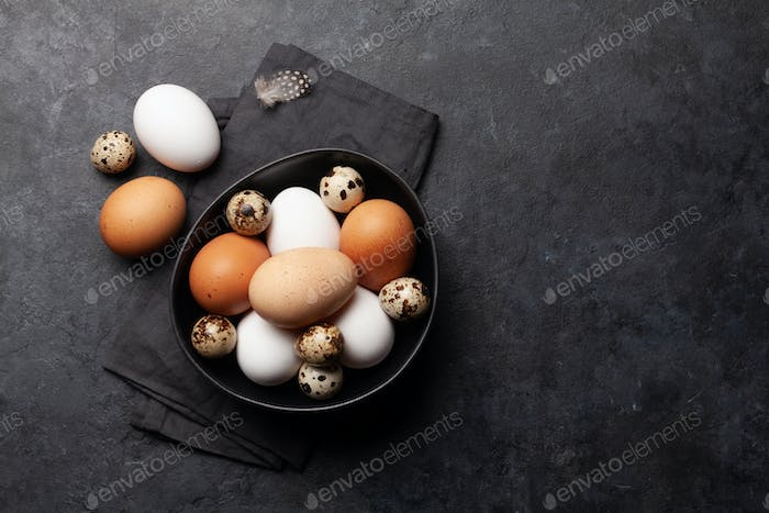 White, brown and quail eggs