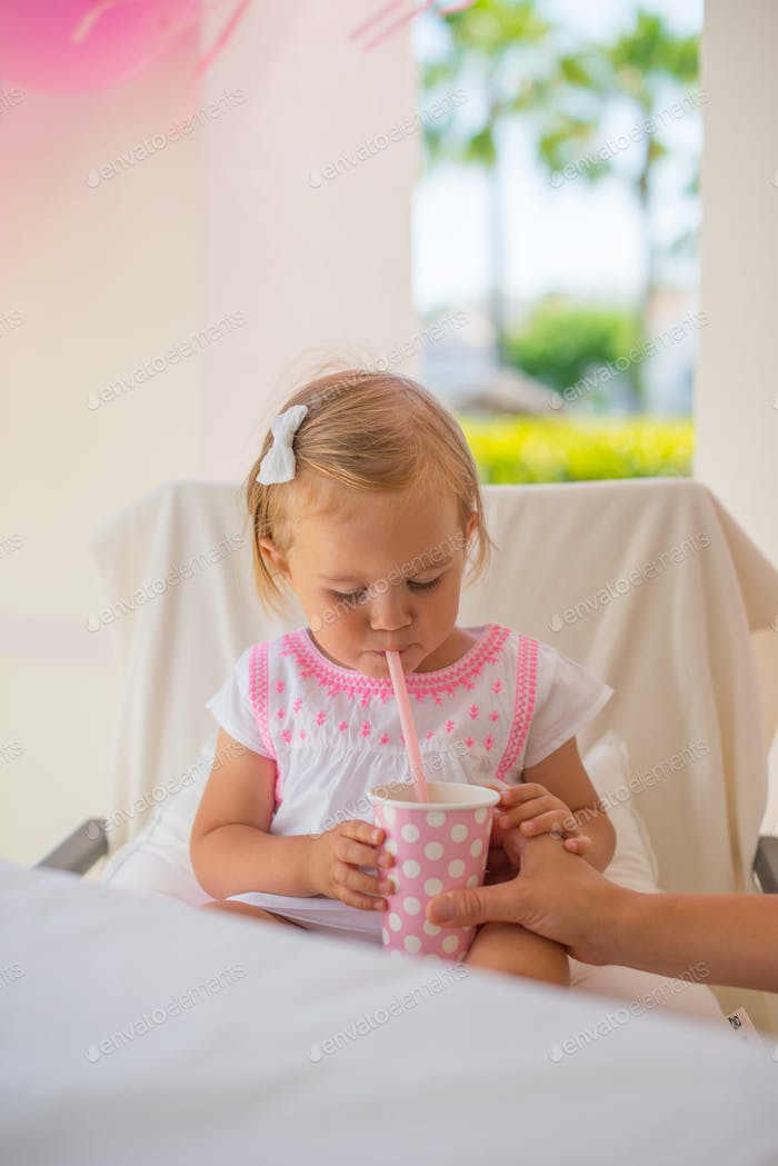 Mother Gives Her Daughter Drink
